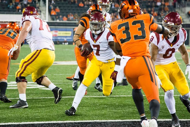Nov 3, 2018; Corvallis, OR, USA; USC Trojans running back Stephen Carr (7) scores a touchdown during the first half against the Oregon State Beavers at Reser Stadium. Mandatory Credit: Troy Wayrynen-USA TODAY Sports