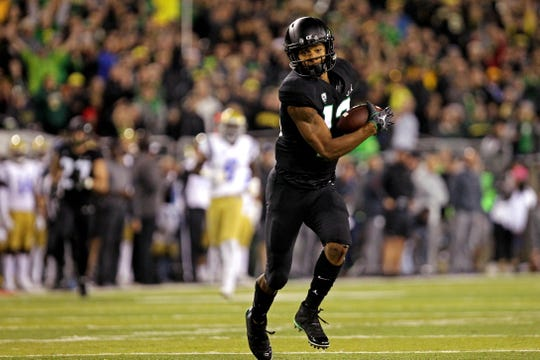 Oregon wide receiver Dillon Mitchell (13) makes a catch for a touchdown against UCLA at Autzen Stadium.