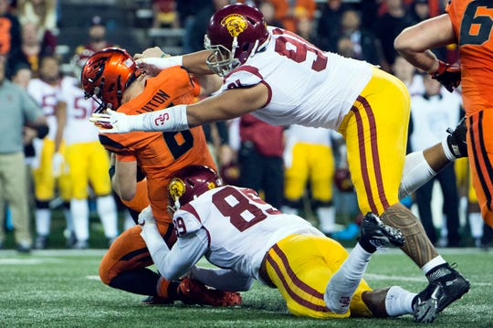 Nov 3, 2018; Corvallis, OR, USA; USC Trojans defensive lineman Brandon Pili (91) and defensive lineman Christian Rector (89) sack Oregon State Beavers quarterback Jake Luton (6) during the second half at Reser Stadium. The Trojans beat the Beavers 38-21. Mandatory Credit: Troy Wayrynen-USA TODAY Sports