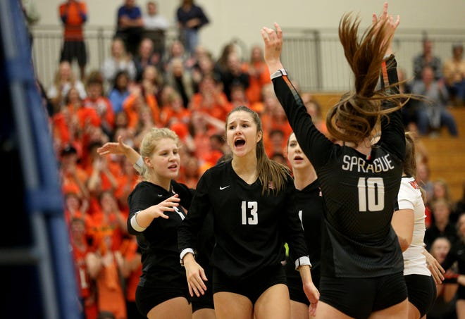 Sprague teammates celebrate during the OSAA 6A Volleyball State Championship on Saturday, Nov. 3, 2018 in Hillsboro.