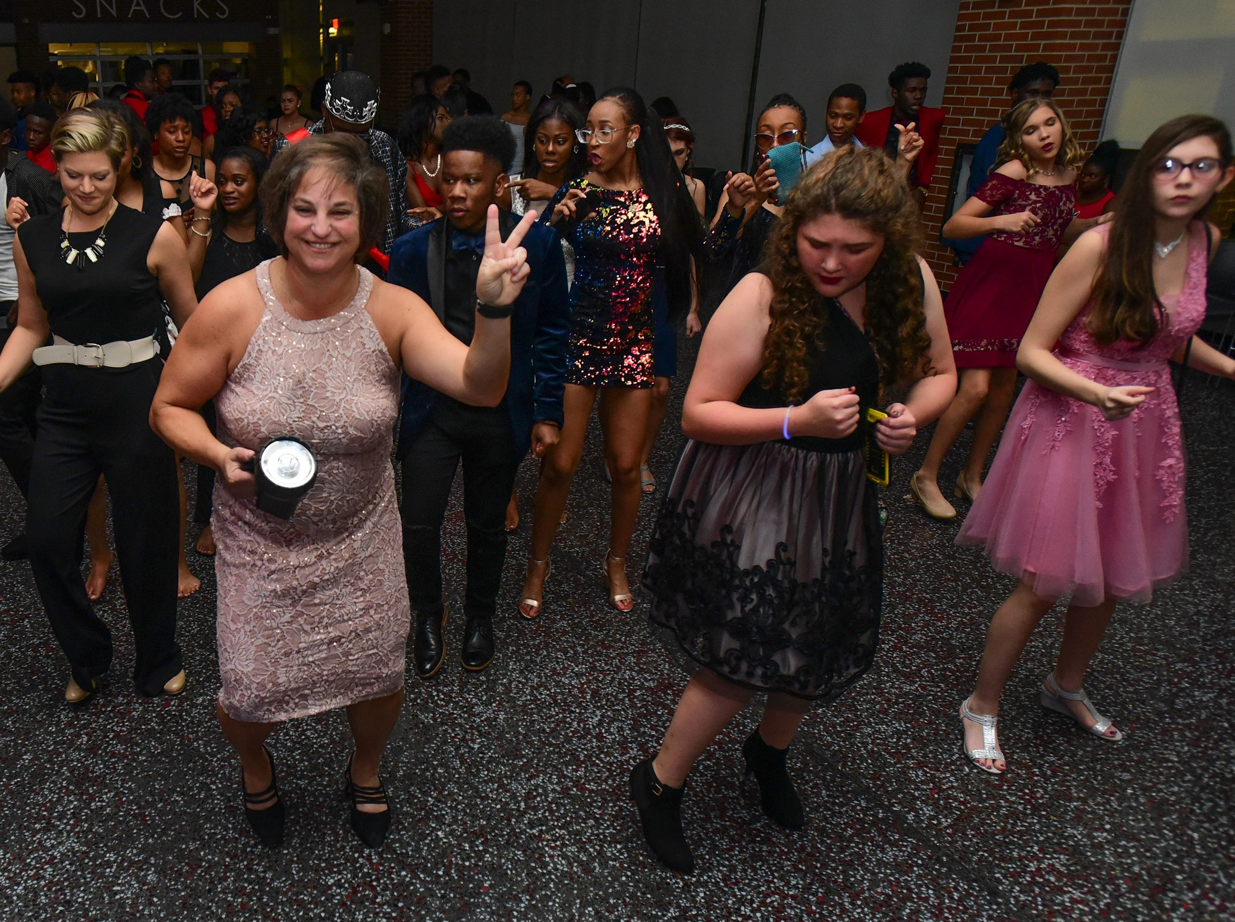Assistant Principal Erin Nathan, left, and Principal Amy Eskridge dance at James M. Bennett High School Homecoming Dance Saturday night at the school in Salisbury. 780 youth attended the annual dance.