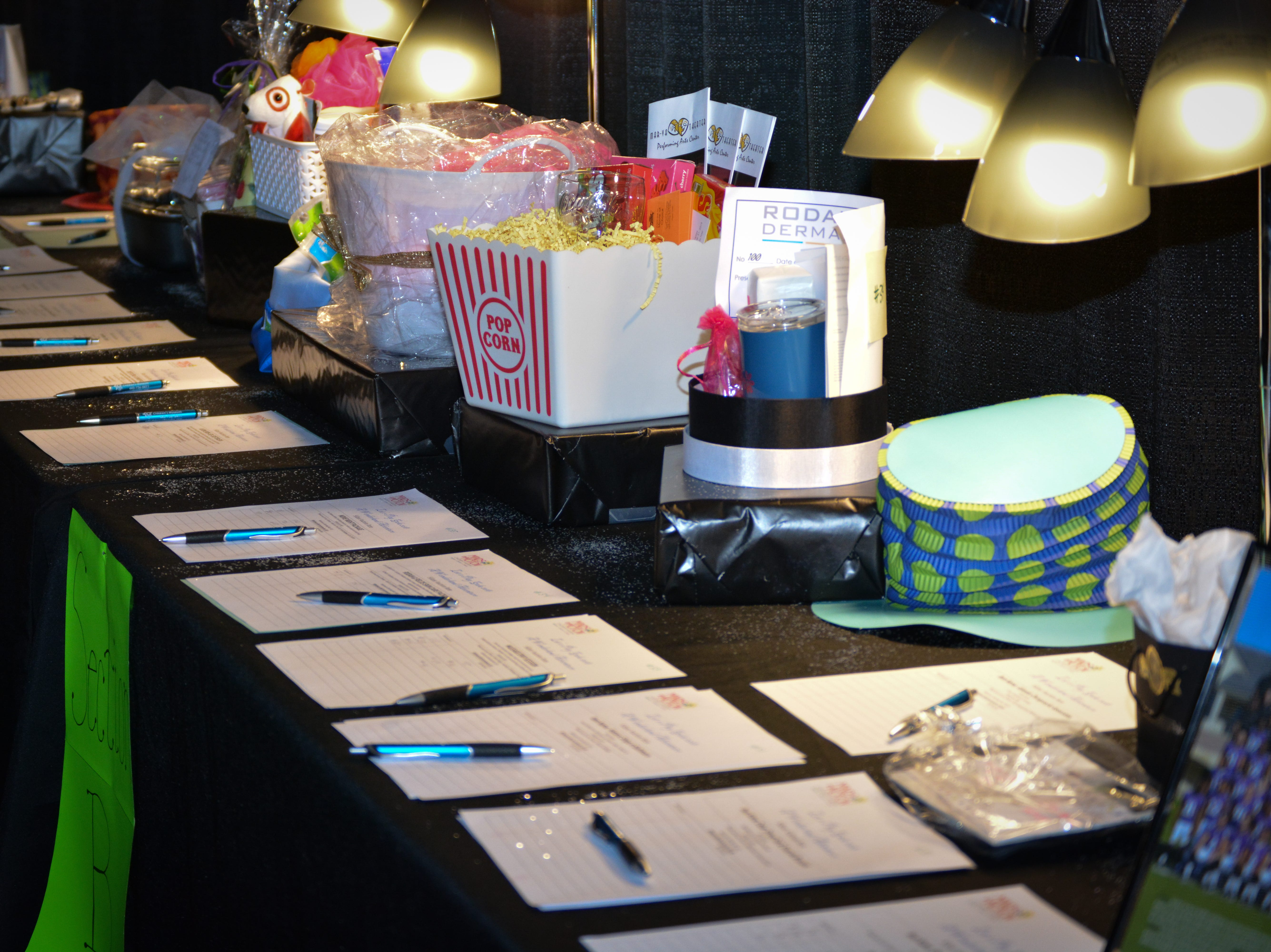 """Auctions items await bids at the Minds in Motion Museum """"A Wonderland Adventure Gala"""" on Nov. 3, 2018, at the Wicomico Youth & Civic Center in Salisbury, Maryland."""