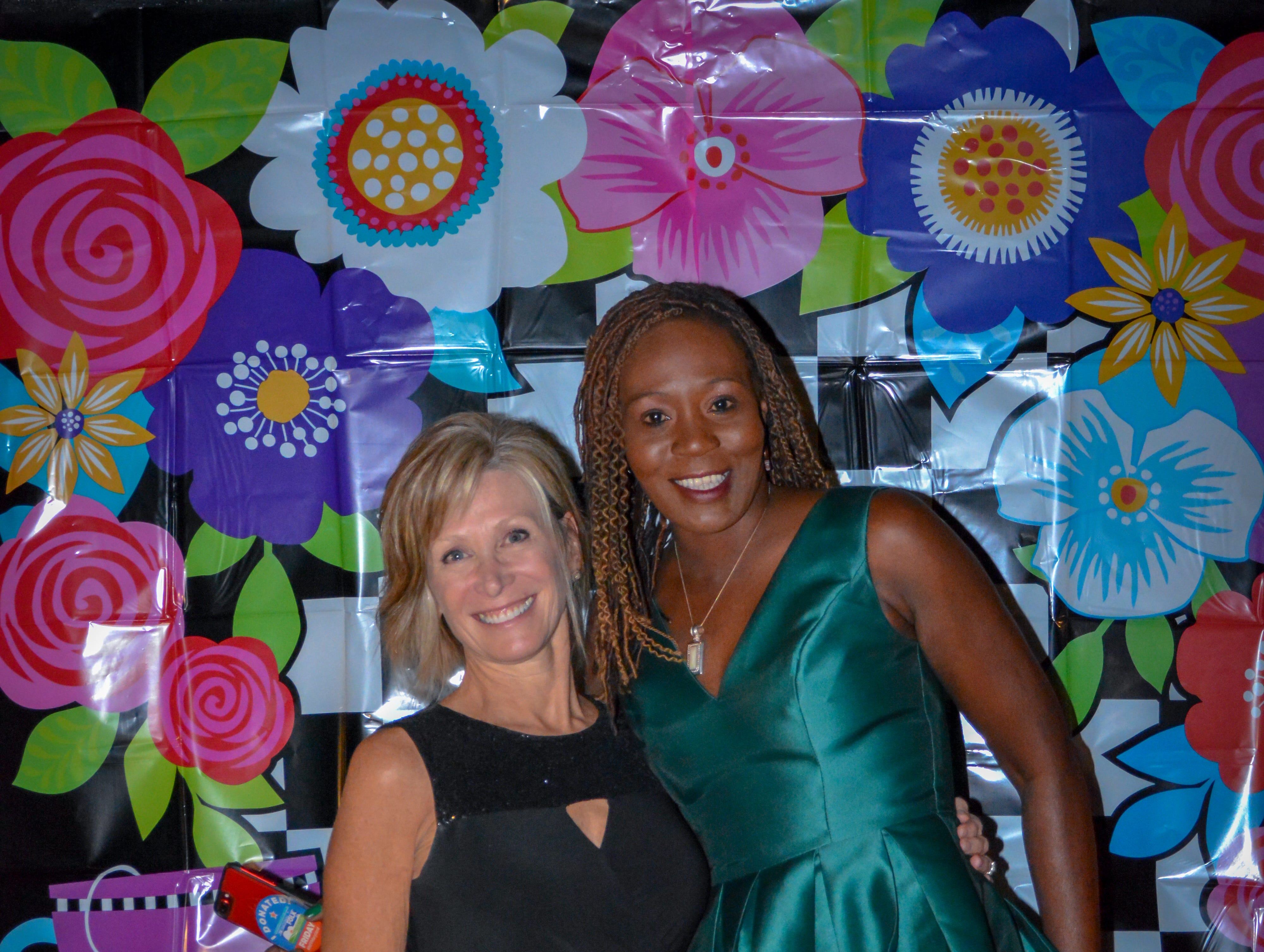 """Wicomico County Circuit Court Judge Kathleen Beckstead, (left) and Shawn Kearstey, board member, pose for a quick picture at the Minds in Motion Museum """"A Wonderland Adventure Gala"""" on Nov. 3, 2018, the Wicomico Youth & Civic Center in Salisbury, Maryland."""