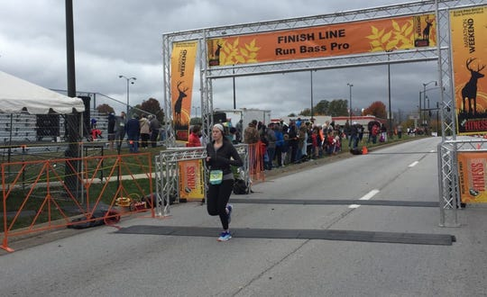 Elyce Cicotte finishes her first marathon.