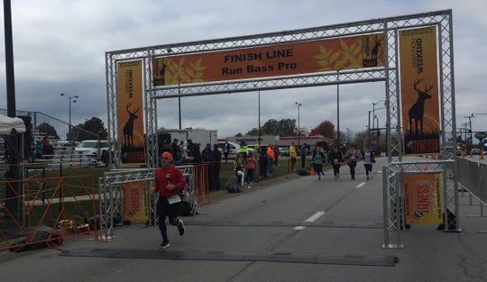 Chad Edelen finishes his first marathon.