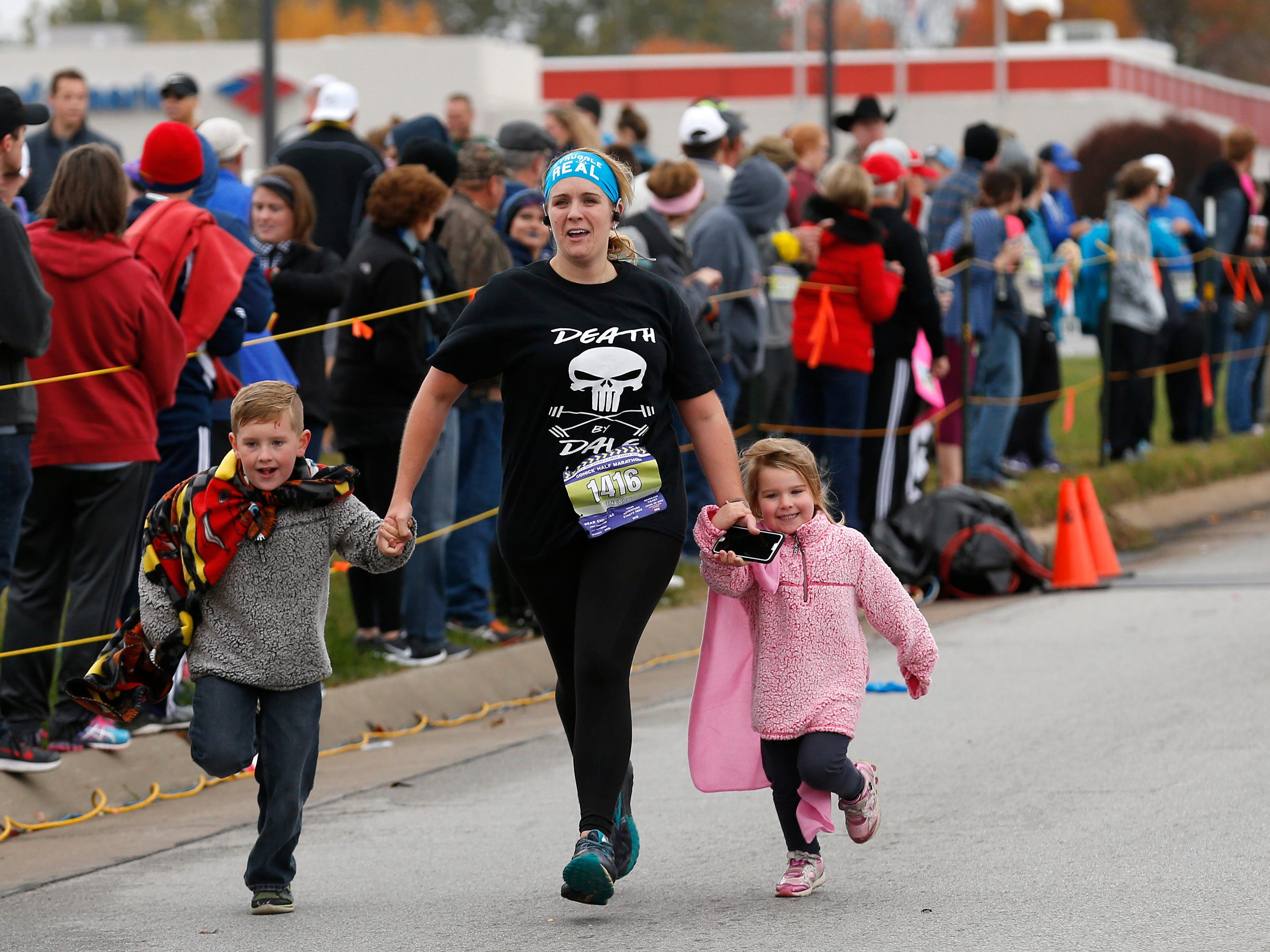 Participants cross the finish line of the Cohick Half Marathon on Sunday, Nov. 4, 2018.