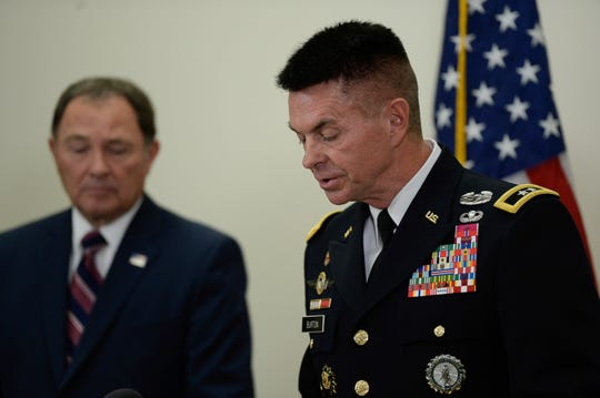 Gov. Gary Herbert, left, and Maj. Gen. Jefferson S. Burton address the media on Sunday, Nov. 4, 2018, in Draper, Utah. Military officials say a major in Utah's Army National Guard who was also the mayor of a city north of Salt Lake City was killed in Afghanistan after being shot by a member of the Afghan security forces. They say Brent Taylor was in the country to train Afghan commandos and was shot Saturday, Nov. 3, 2018, by one of the trainees at the Kabul military training center. The attacker was then killed by Afghan forces. (Francisco Kjolseth/The Salt Lake Tribune, via AP)