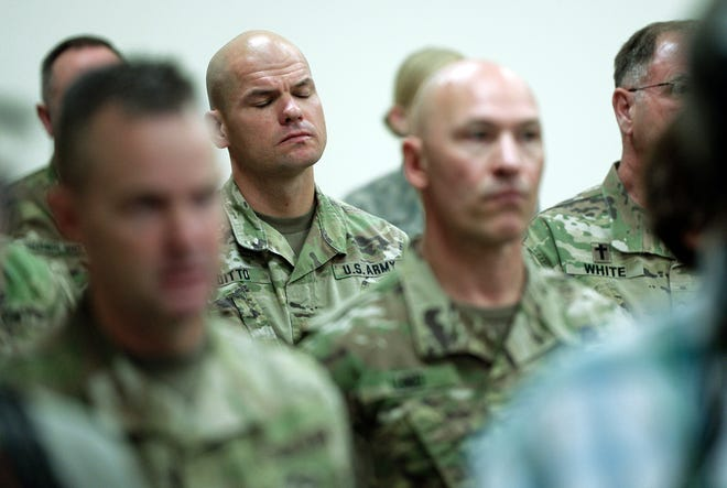 Soldiers attend a news conference where Gov. Gary R. Herbert and Maj. Gen. Jefferson S. Burton address the media Sunday, Nov. 4, 2018, in Draper, Utah. Military officials say a major in Utah's Army National Guard who was also the mayor of a city north of Salt Lake City was killed in Afghanistan after being shot by a member of the Afghan security forces. They say North Ogden Mayor Brent Taylor was in the country to train Afghan commandos and was shot Saturday, Nov. 3, 2018, by one of the trainees at the Kabul military training center. The attacker was then killed by Afghan forces. (Francisco Kjolseth/The Salt Lake Tribune, via AP)