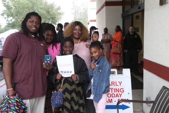 Proud voters pose for a photo on the last day of early voting and day of Souls to the Polls, at the Leroy Collins Leon County Public Library, on Sunday, Nov. 4, 2018,