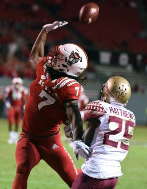 FSU wide receiver D.J. Matthews has a pass knocked away by an N.C. State defender in the Seminoles' 47-28 loss in Raleigh.