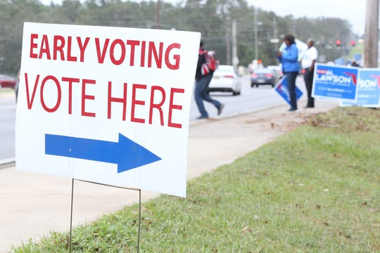 Campaign supporters lined the street on the last day of early voting and day of Souls to the Polls, at the Leroy Collins Leon County Public Library, on Sunday, Nov. 4, 2018,
