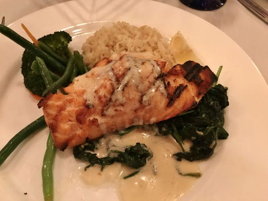 Pietro's on the River's Salmon Florentine on a bed of sautéed spinach and drizzled with a white wine sauce.