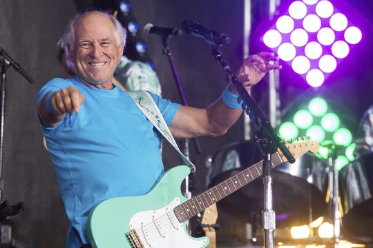 """This July 29, 2016 file photo shows Jimmy Buffett performing on NBC's """"Today"""" show in New York.  Buffett is opening a retirement village. Jimmy Buffet's Latitude Margaritaville will open its first community in Daytona Beach, Fla., in the fall. (Photo by Charles Sykes/Invision/AP, File)"""