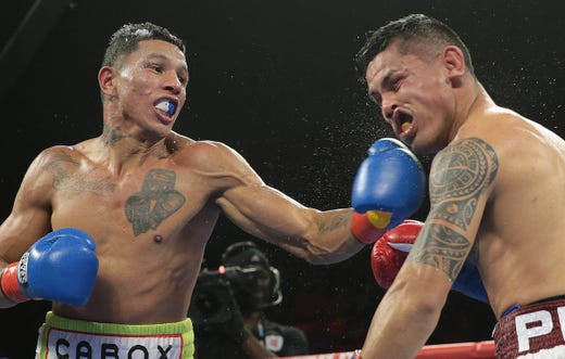 "A wild night of boxing Saturday night at the Don Haskins Center. In the main event Juarez boxer Miguel ""Mickey"" Roman showed a lot of toughness in his ninth round TKO loss to WBC super featherweight belt holderMiguel Berchelt from Cancun."