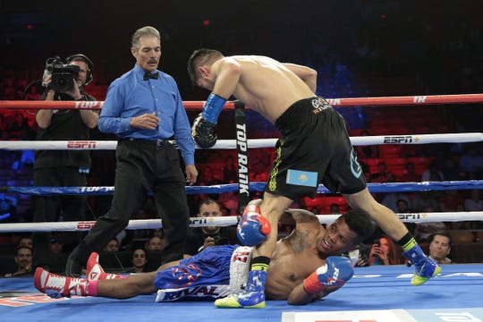 Puerto Rican boxer Nicklaus Flaz (blue trunks) came back from a beating and a knock down to defeat Sagadat Rakhmankul of California in their bout Saturday at the Don Haskins Center.