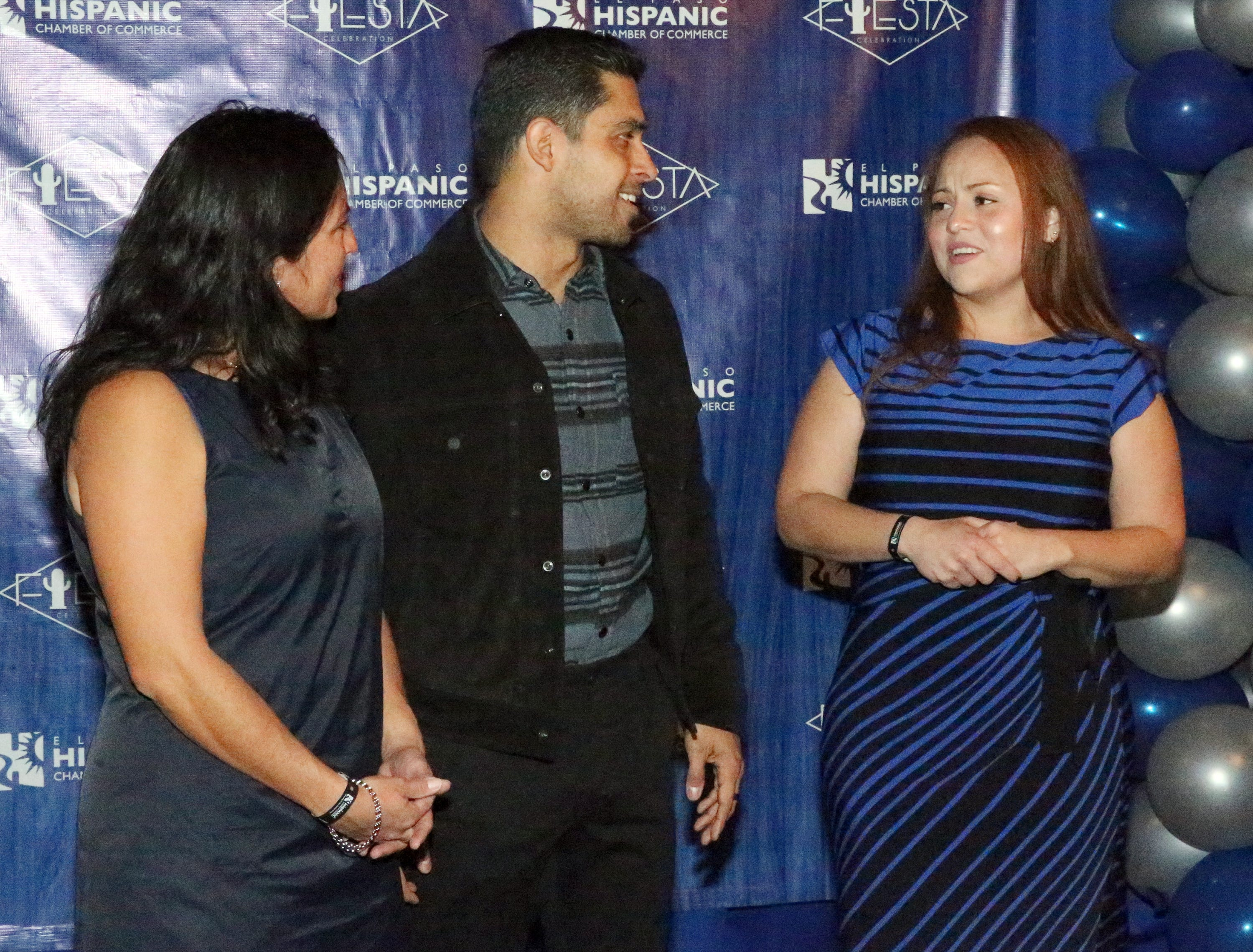 Actor/producer Wilmer Valderrama, center, talks with Alina Gonzalez, right, and Yesenia Castro, left, during a reception at the 28th El Paso Hispanic Chamber of Commerce annual Fiesta Celebration Saturday night at the Centennial Banquet and Conference Center at Fort Bliss.