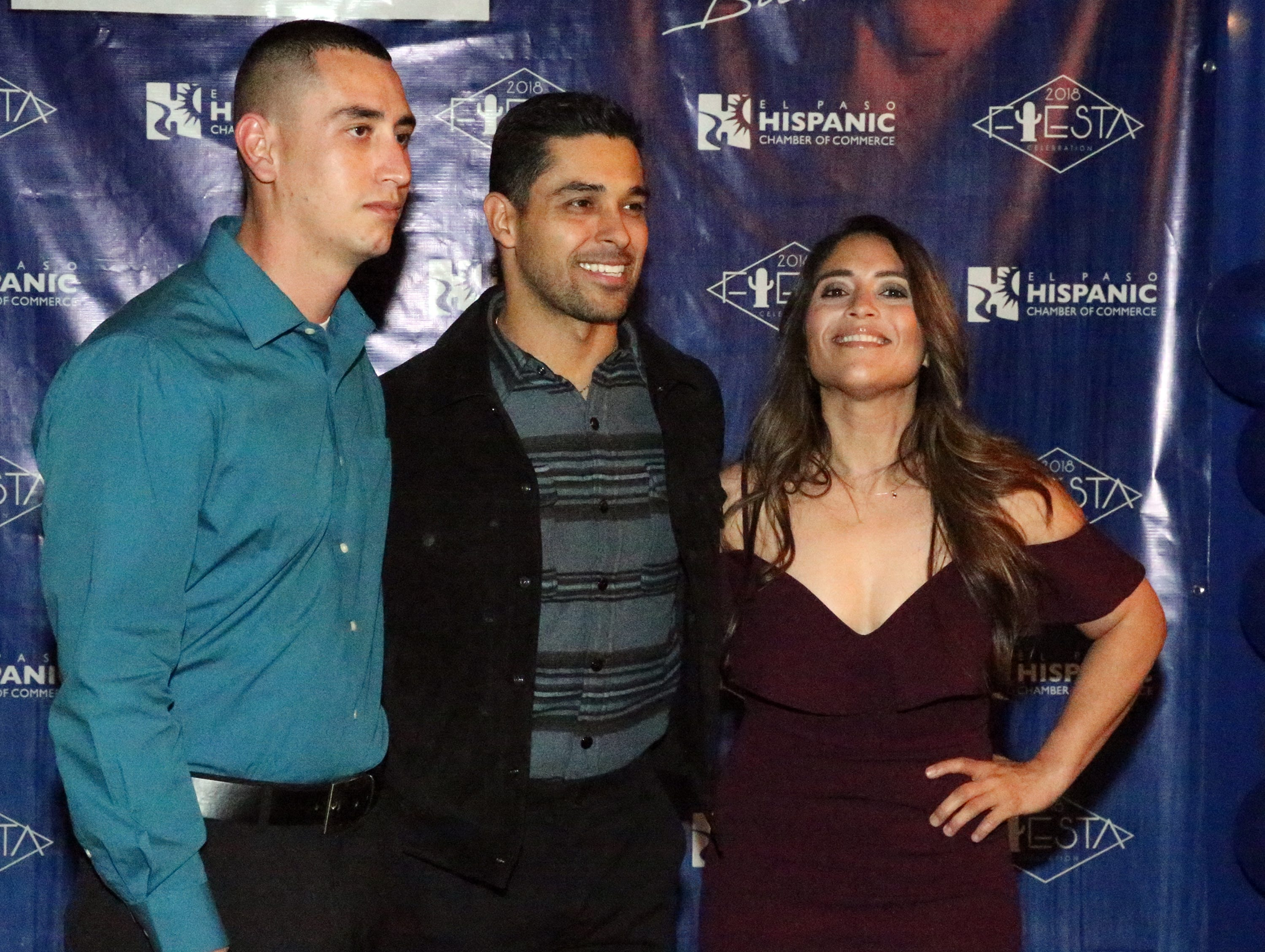 Cesar Jimenez, left, and Samira Hernandez, right, pose with actor/producer Wilmer Valderrama Saturday.
