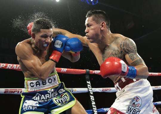 """A wild night of boxing Saturday night at the Don Haskins Center. In the main event Juarez boxer Miguel """"Mickey"""" Roman showed a lot of toughness in his ninth round TKO loss to WBC super featherweight belt holderMiguel Berchelt from Cancun."""