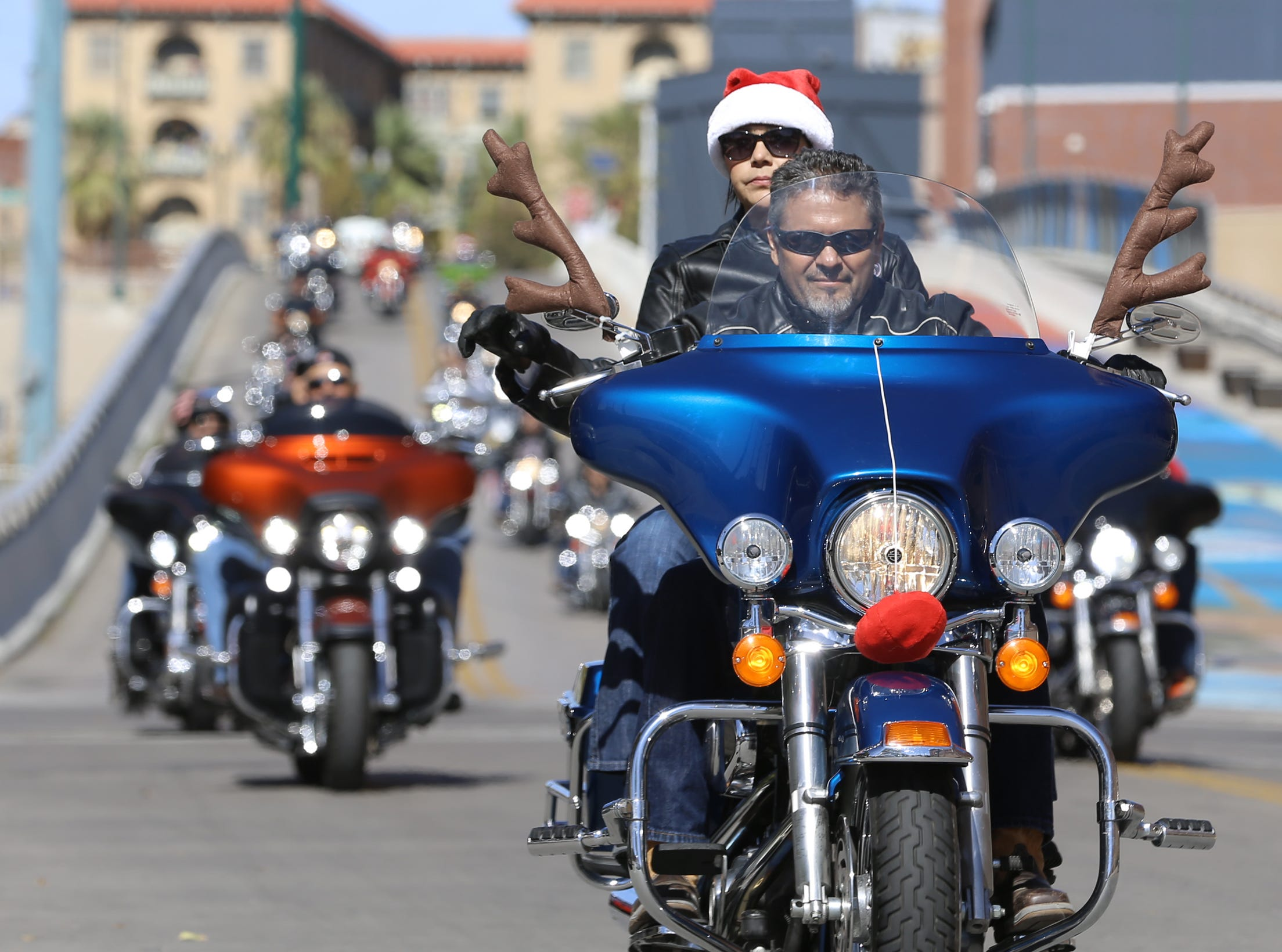 Thousands of bikers with the El Paso Motorcycle Coalition strapped toys to their bikes and rode through the streets of El Paso Sunday to bring Christmas to poor children. The miles-long caravan of bike stretched miles as they rode from Sunland Park, New Mexico to the El Paso County Coliseum.