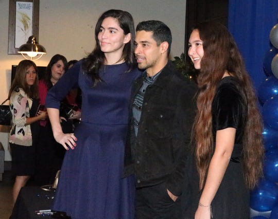 Actor/producer Wilmer Valderrama, center, poses for a picture with sisters Kasandra and Tracy Huhn during a reception at the 28th El Paso Hispanic Chamber of Commerce annual Fiesta Celebration Saturday night at the Centennial Banquet and Conference Center at Fort Bliss.
