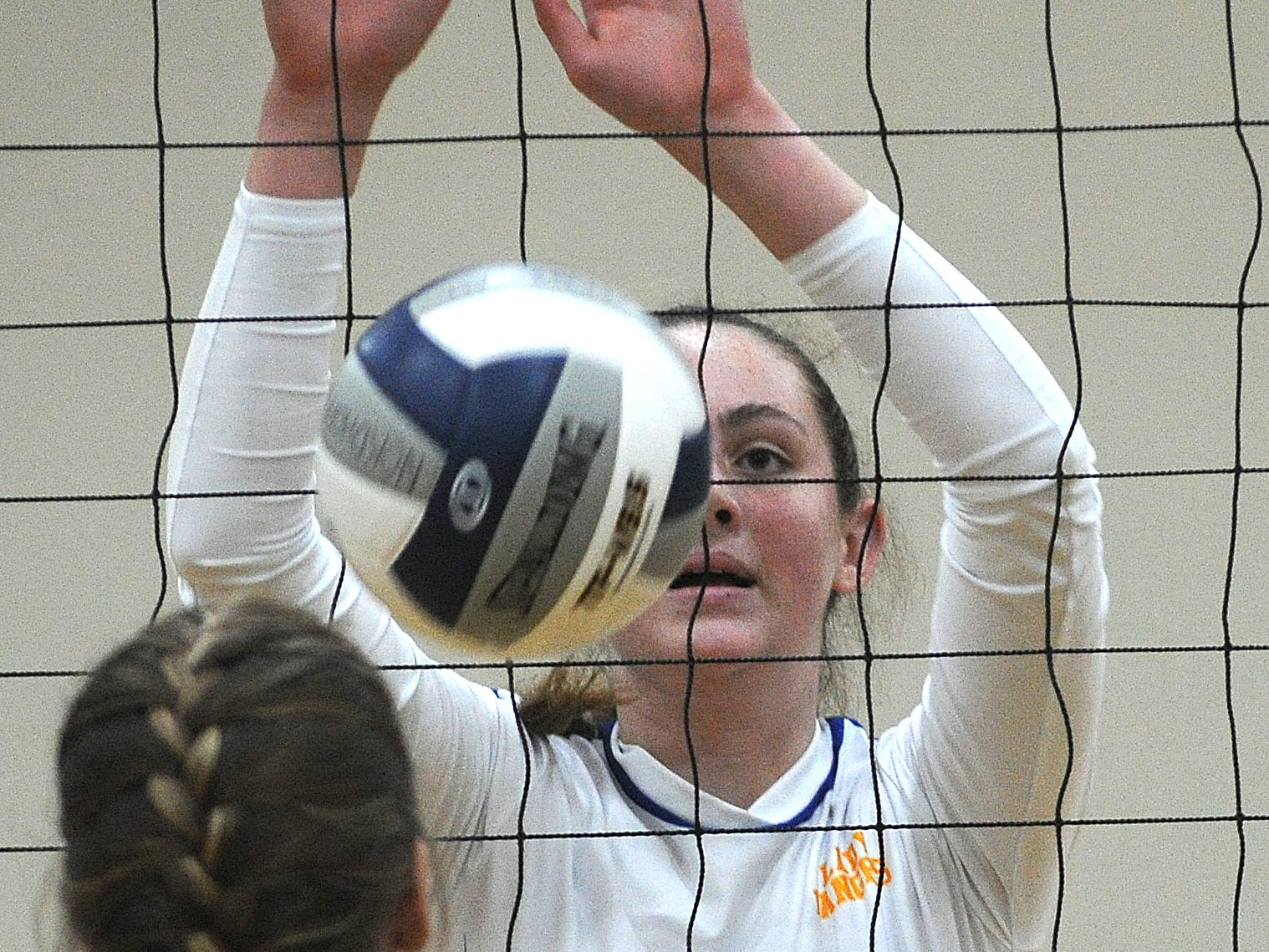 Nordhoff High's Lauren Dingman goes for the block against Linfield Christian in the CIF-SS Division 7 final Saturday.