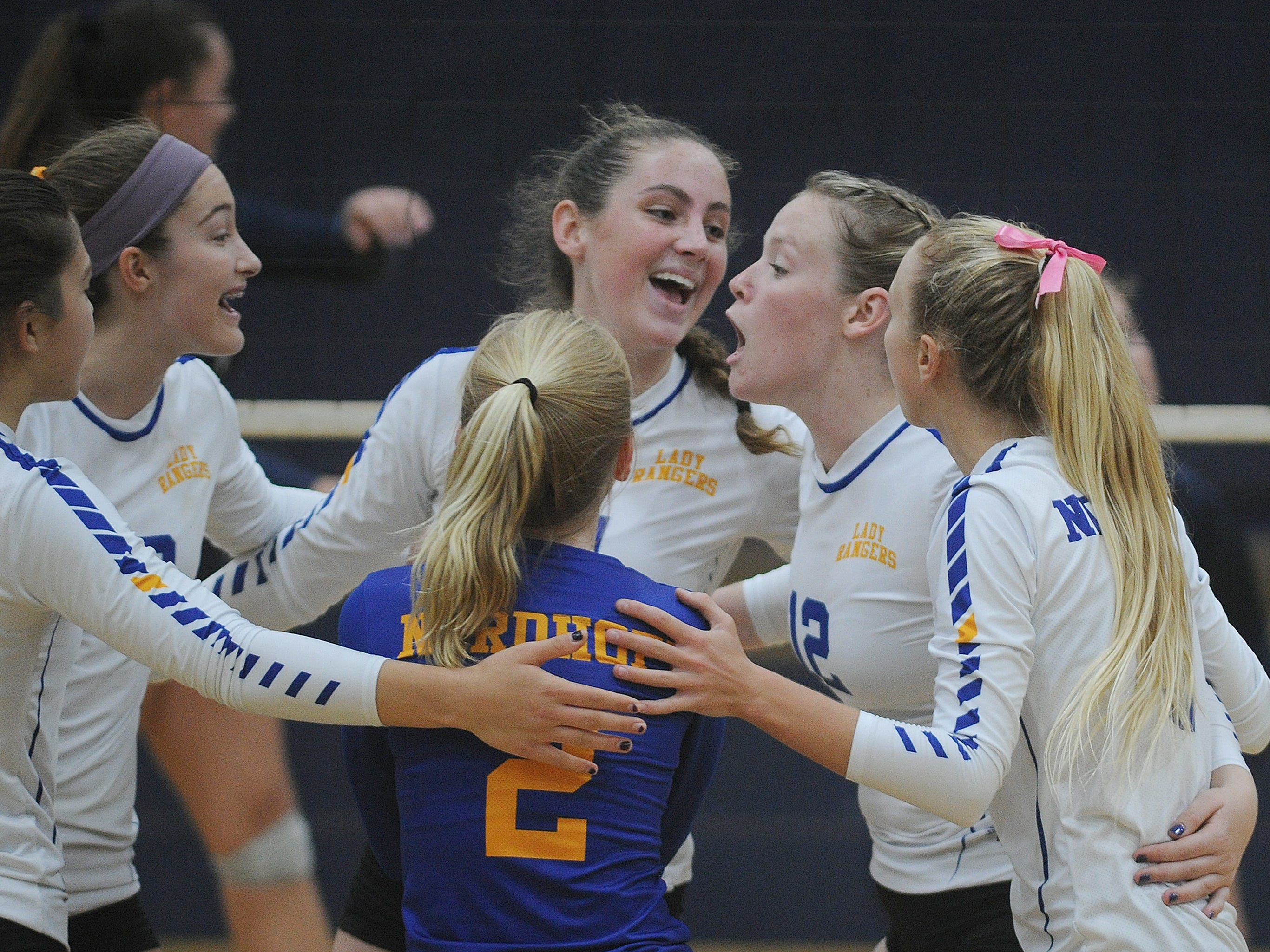 Nordhoff High players celebrate a point against Linfield Christian during the CIF-SS Division 7 girls volleyball final Saturday.