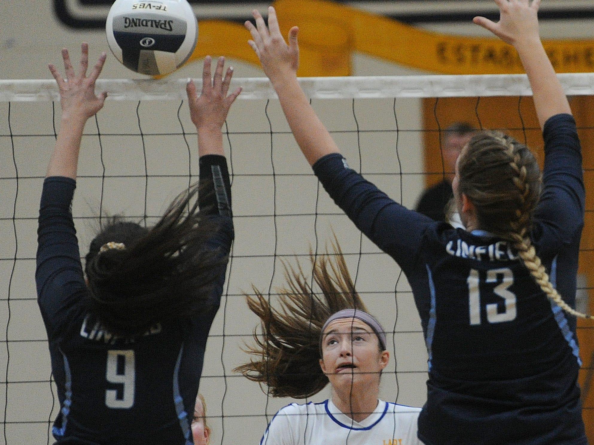 Kolby Fink (center) of Nordhoff watches Linfield Christian's Kelly Rausch (9) and Paige Williams (13) go for the block during the CIF-SS Division 7 final Saturday.