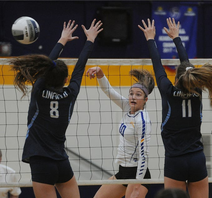 Kolby Fink of Nordhoff makes a kill against Alaina Tucker (8) and Payton Howle of Linfield Christian in the CIF-SS Division 7 final Saturday. The Rangers lost in four games.