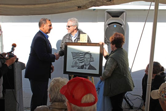 Representatives from the Millville Army Air Field Museum present Congressman Frank LoBiondo with a portrait in honor of his work on behalf of veterans.