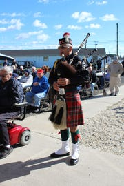 A bagpiper performs Amazing Grace.
