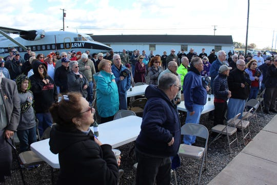 Visitors stand for the Pledge of Allegiance during the Veterans Appreciation Day ceremony on Saturday at the Millville Executive Airport.