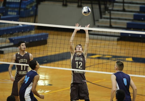 Clarkstown South's Johnny Ferraro (12) reaches for a set during their 3-2 win over Suffern to claim the boys Section 1 volleyball title at Pace University in Pleasantville on Sunday, November 4, 2018.