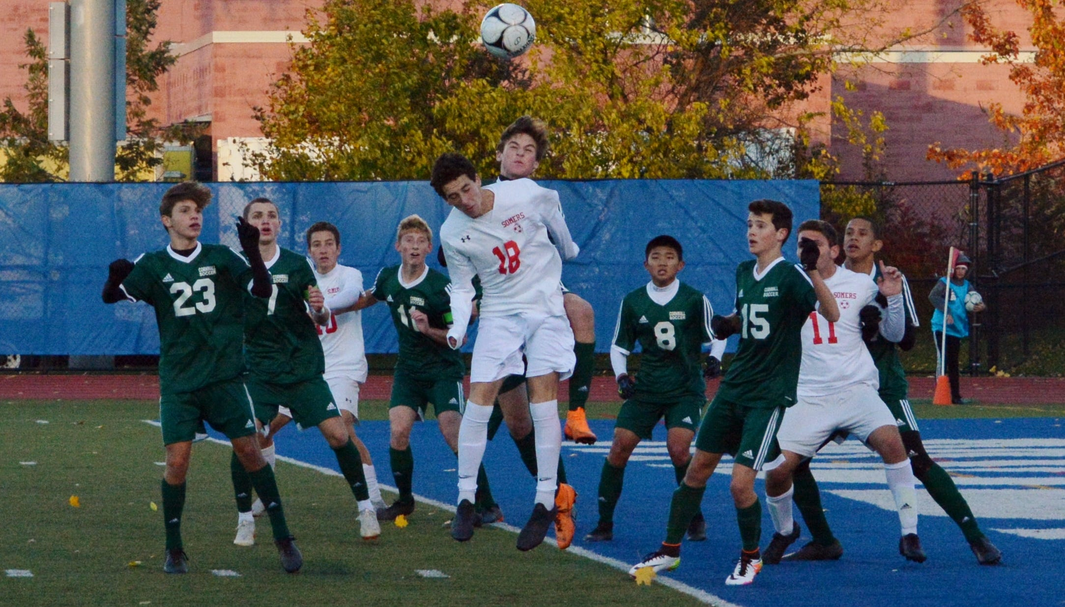 Evan Mazzola wins a ball off a throw in during the first half on Saturday. He later set up the first Somers goal.