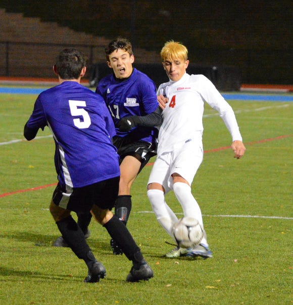 Ketcham forward Drew Rathbun controls the ball in the box in the final seconds of a 2-1 loss to Monroe-Woddbury in a NYSPHSAA Class AA regional final on Saturday, Nov. 3, 2018 at Middletown High School