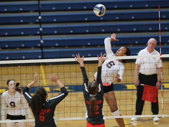 Ossining's Mychael Vernon (6) hits a kill shot during their 3-2 win over North Rockland in the girls class AA volleyball section title game at Pace University in Pleasantville on Sunday, November 4, 2018.