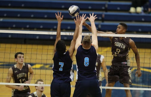 Clarkstown South's Miles Fisher (9) pushes a shot past Suffern's Saohil Dutta (7) and Danny Kenny (8) during their 3-2 win over Suffern to claim the boys Section 1 volleyball title at Pace University in Pleasantville on Sunday, November 4, 2018.