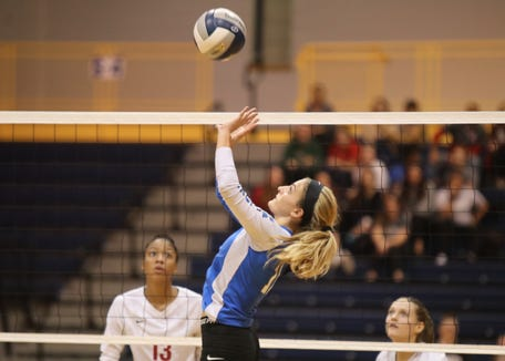 Hen Hud's Callie Pidoriano (11) sets a shot during their 3-1 over Nyack in the girls class A volleyball section finals at Pace University in Pleasantville on Saturday, November 3, 2018.