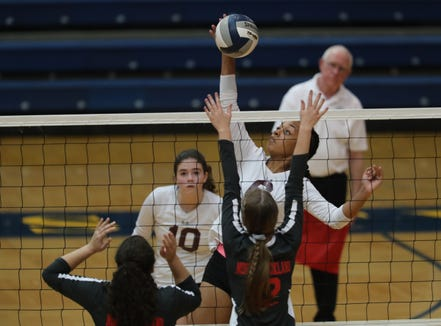 Ossining's Mychael Vernon (6) puts a shot over the net during their 3-2 win over North Rockland in the girls class AA volleyball section title game at Pace University in Pleasantville on Sunday, November 4, 2018.
