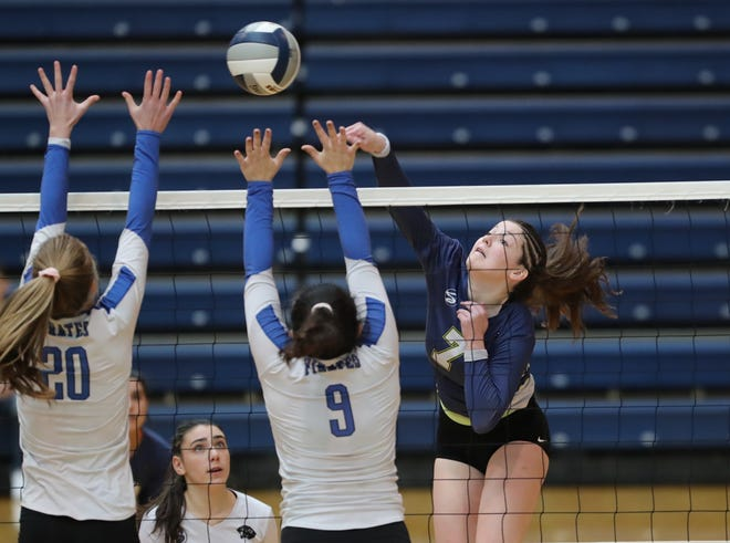 Ardsley's Rory McNerney (6) puts a shot over Pearl River's Camryn McGee (20) and Demetra Tsetsekos (9) during their 3-0 win over Pearl River in the girls class B volleyball section title at Pace University in Pleasantville on Sunday, November 4, 2018.