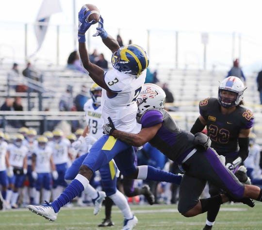 Delaware receiver Joe Walker sets up a Delaware touchdown with a long reception against Albany's Ty Tobias in the second quarter at Albany Saturday.
