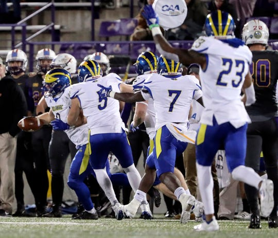 Delaware linebacker Troy Reeder (left) celebrates his interception that ended Albany's chances in the final seconds of the Blue Hens' 21-16 win at Albany in 2018.