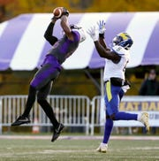 Albany's Jerah Reeves make a catch as Delaware's Tenny Adewusi defends in the second quarter at Albany Saturday.