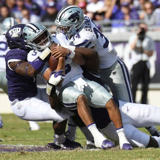 TCU's L.J. Collier (bottom) had two sacks in Saturday's win over Kansas State.