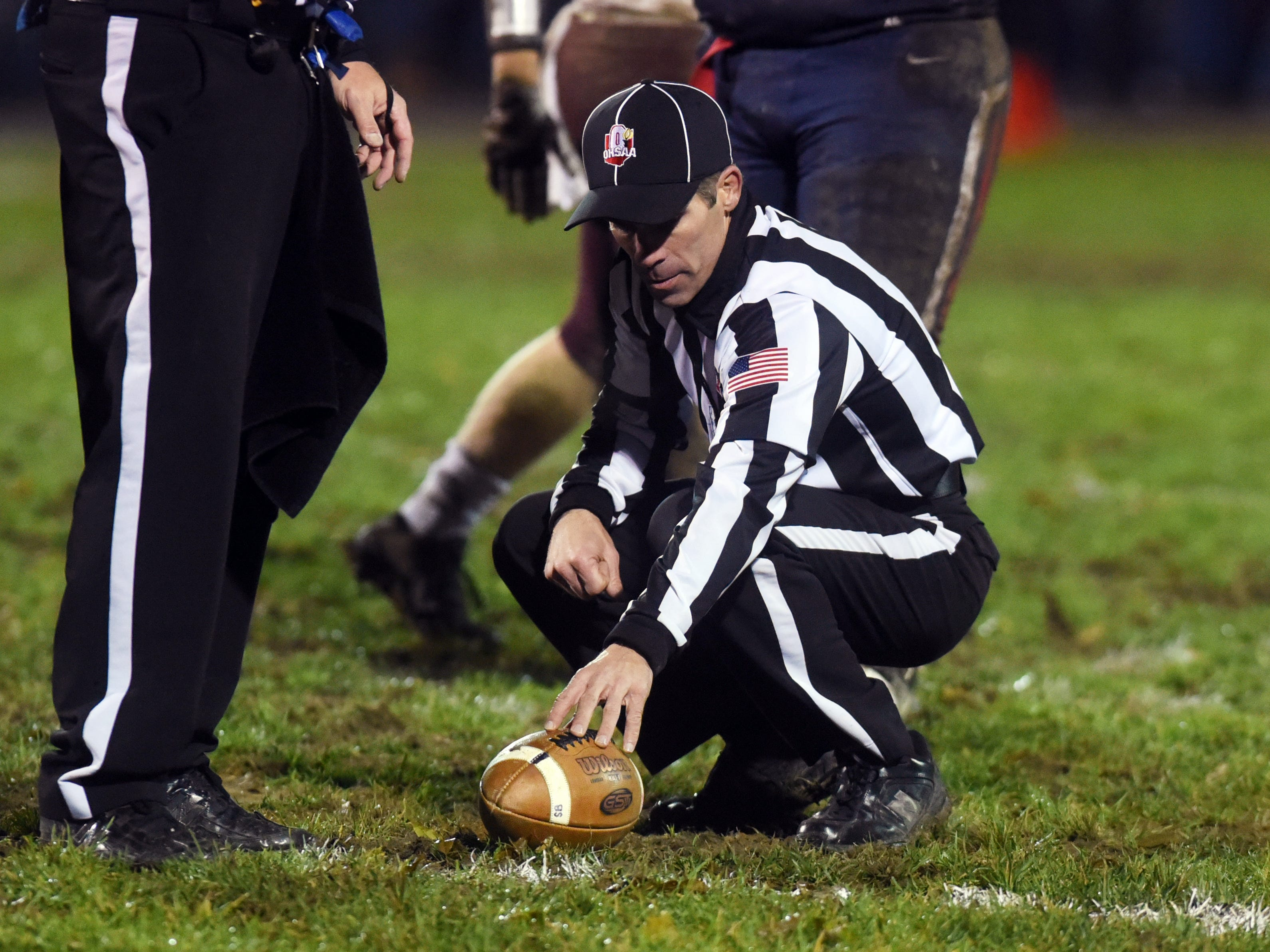 On official measures for a first down late in the fourth quarter of John Glenn's 16-14 playoff loss to host Gnadenhutten Indian Valley on Saturday night.