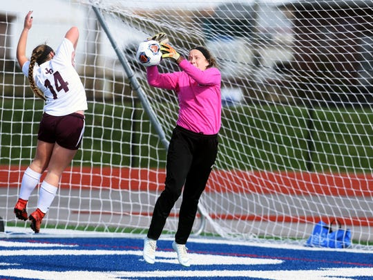 John Glenn goalie Audrey Hague makes a leaping save just before halftime during the Muskies' 3-0 loss to Sunbury Big Walnut on Saturday in a Division II regional final at Lakewood High School.