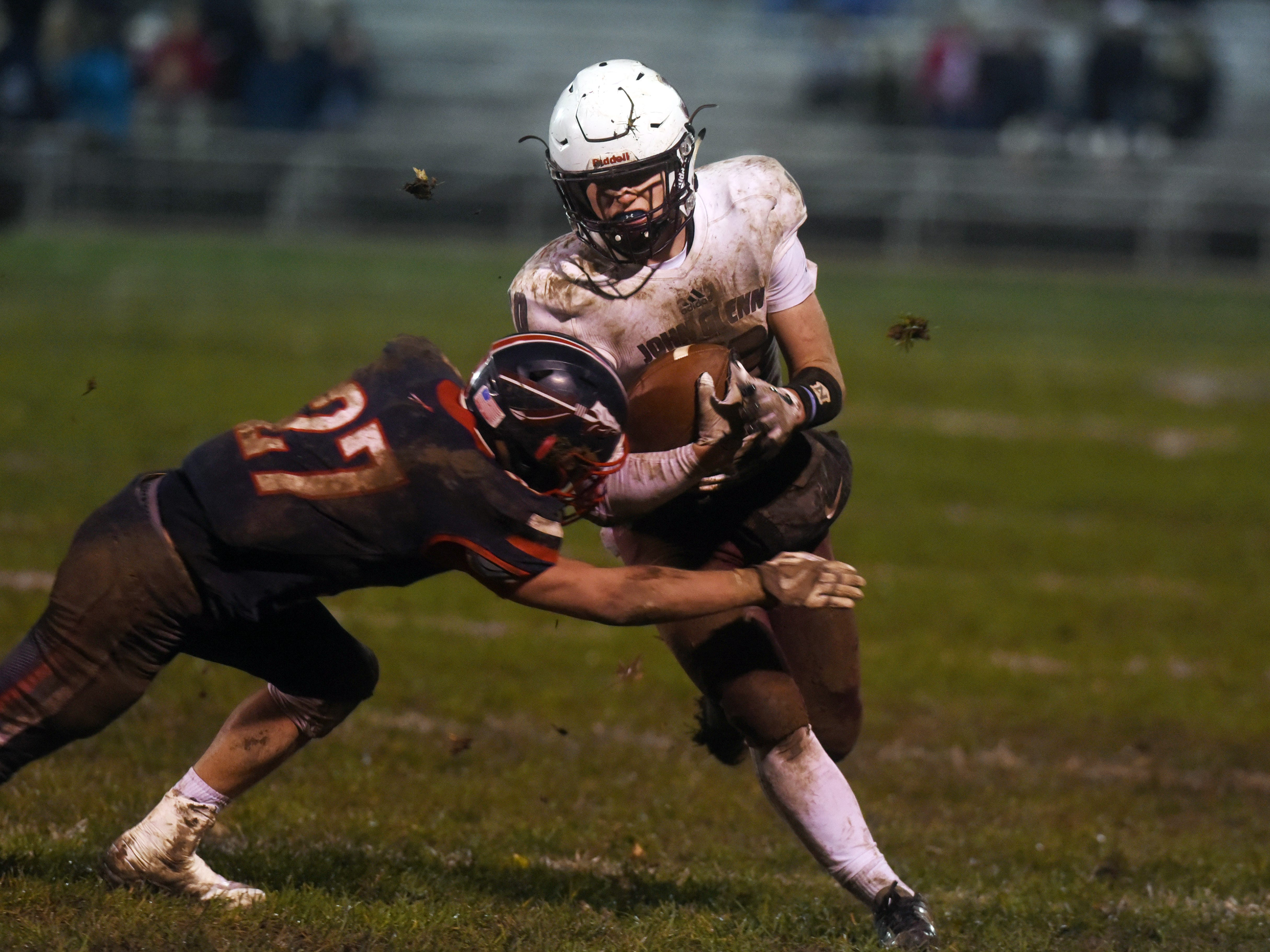 Ben Larson tries to escape a tackle from Zach Love during John Glenn's 16-14 playoff loss to host Gnadenhutten Indian Valley on Saturday night.