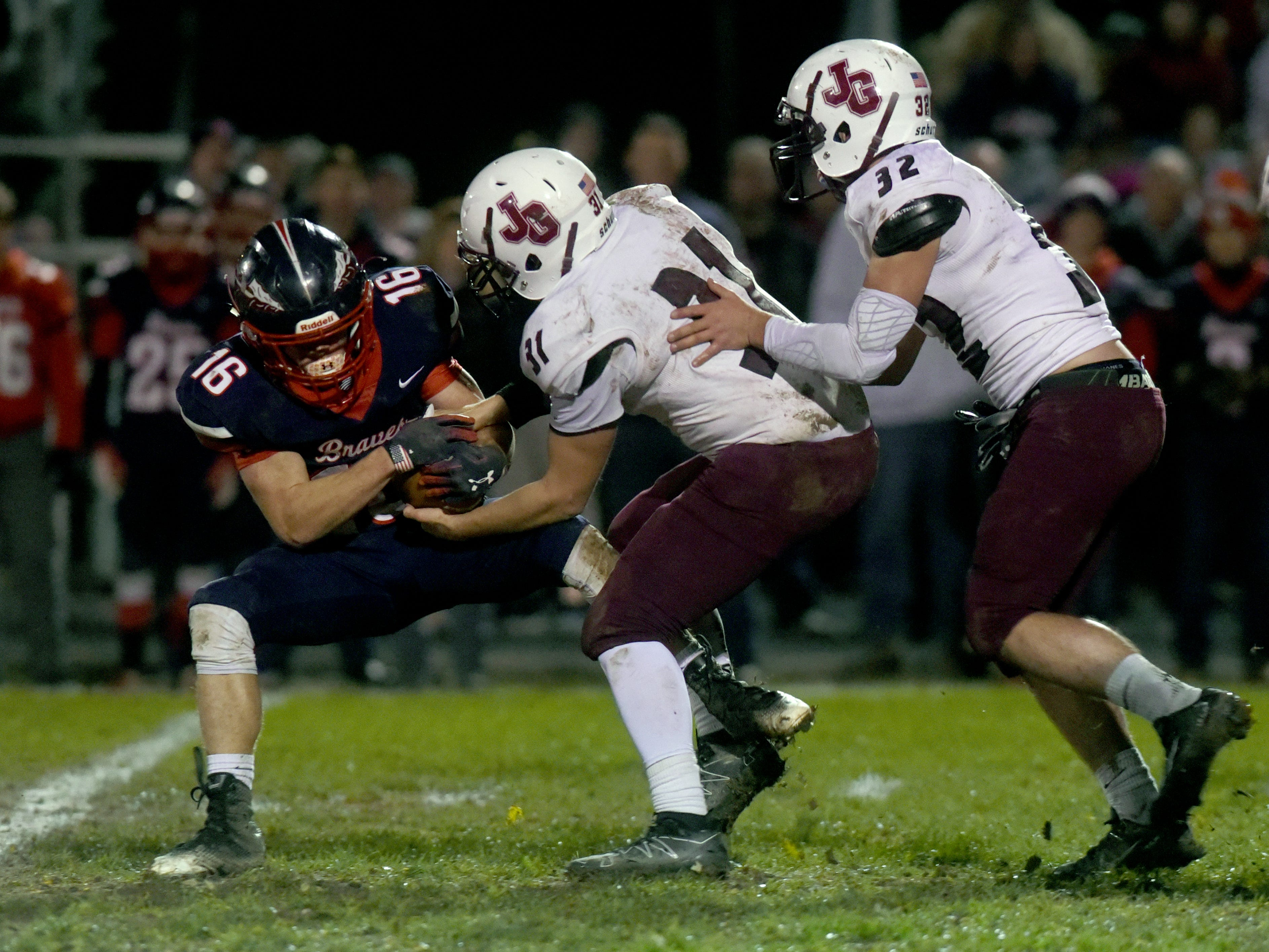 Josh Conner, of John Glenn, tries to take the ball from Indian Valley's Caden Hostetler during a 16-14 playoff loss on Saturday night.