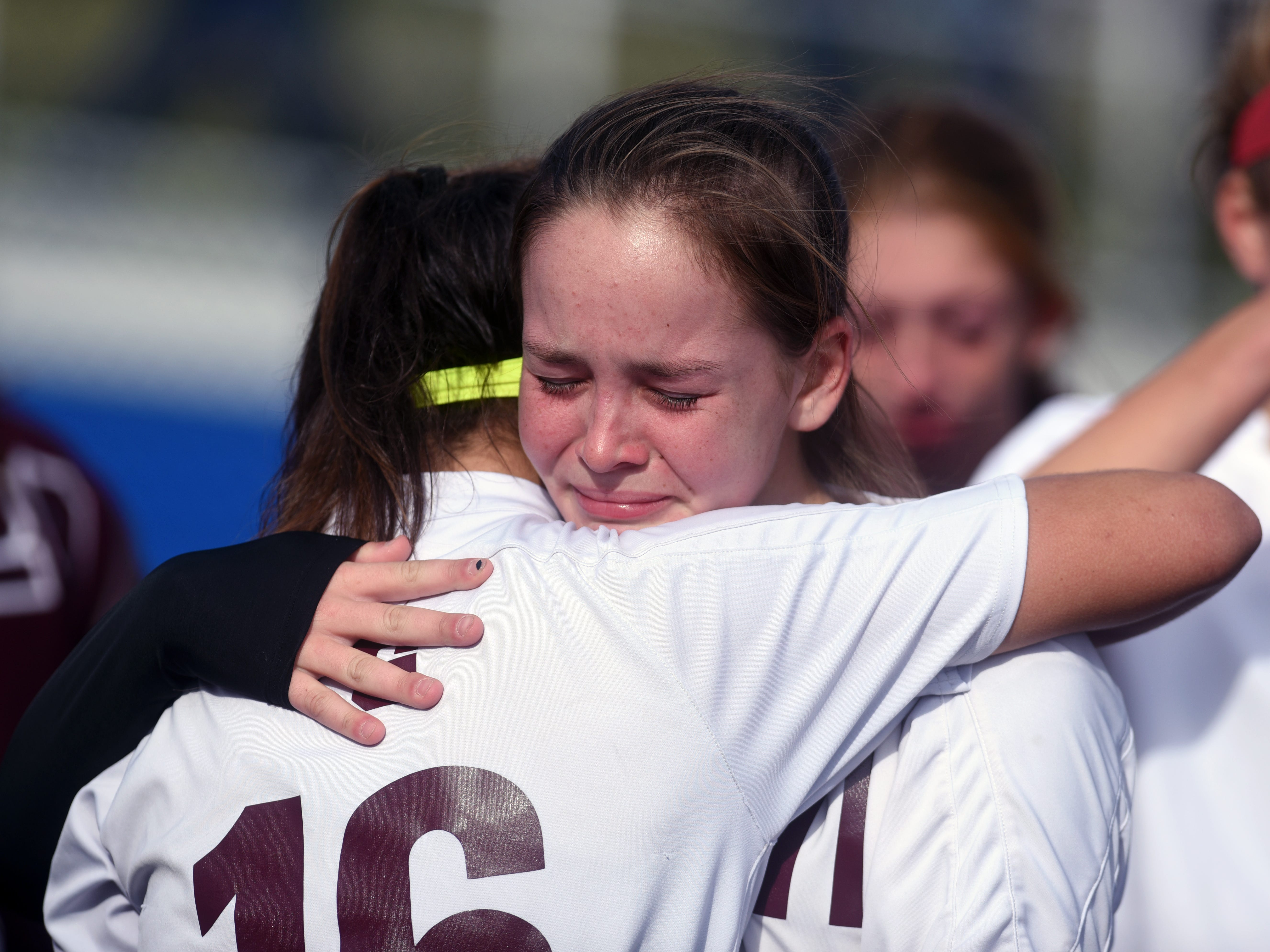 Ashley Townsend, left, and Shi Williamson console each other following John Glenn's 3-0 loss to Sunbury Big Walnut in a Division II regional final at Lakewood High School.