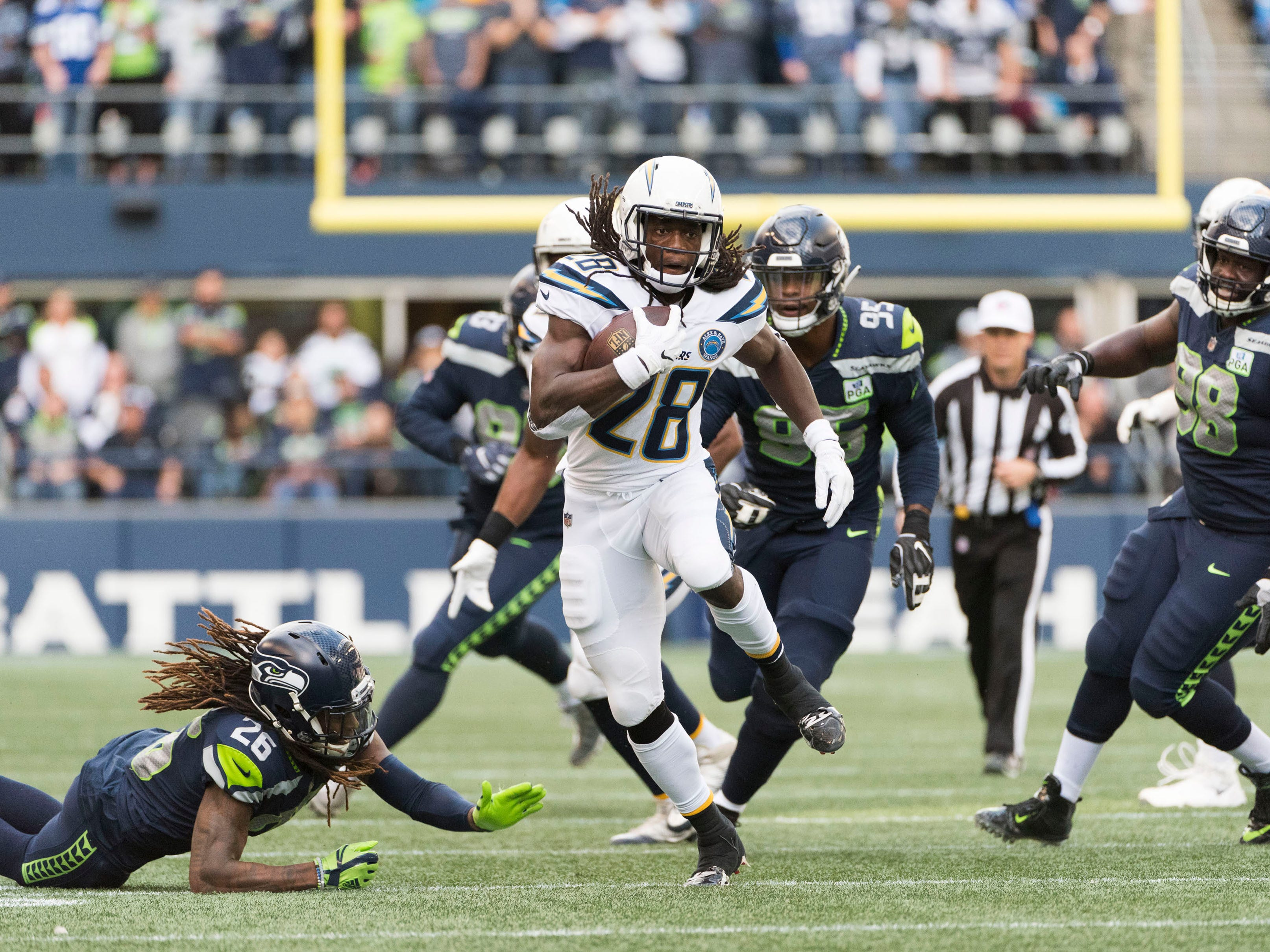 Los Angeles Chargers running back Melvin Gordon (28) gets loose against the Seattle Seahawks during the first half at CenturyLink Field.