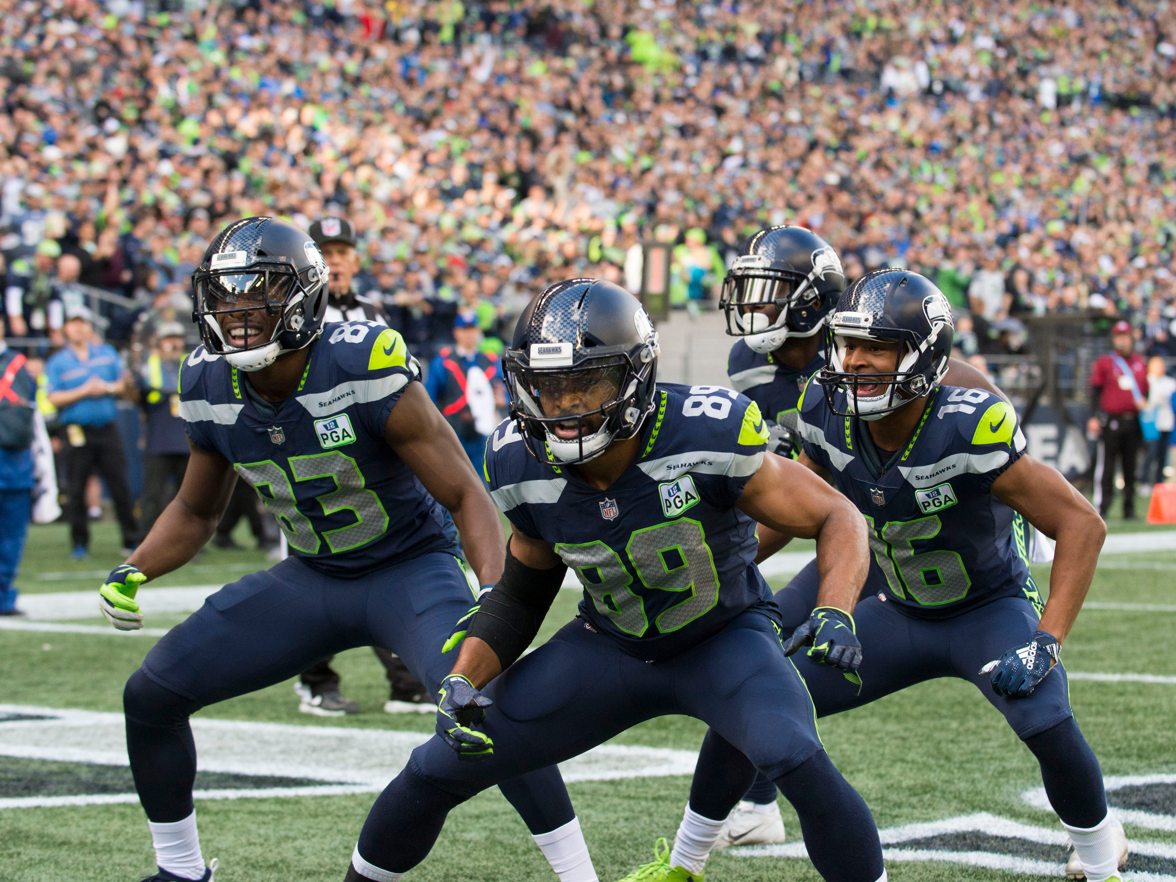 After a first-quarter touchdown, the Seattle Seahawks dance. Wide receivers David Moore (83), Doug Baldwin (89), Tyler Lockett (16) and Jaron Brown (18).